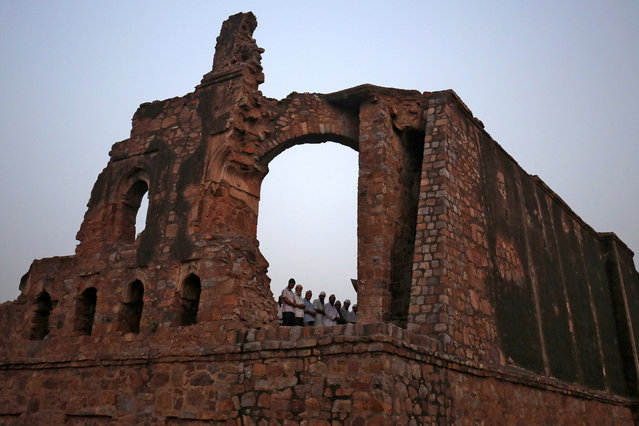 Muslims offer prayers during the holy month of Ramadan at the ruins of the Feroz Shah Kotla mosque in New Delhi, India, May 31, 2018. (Photo by Amit Dave/Reuters)