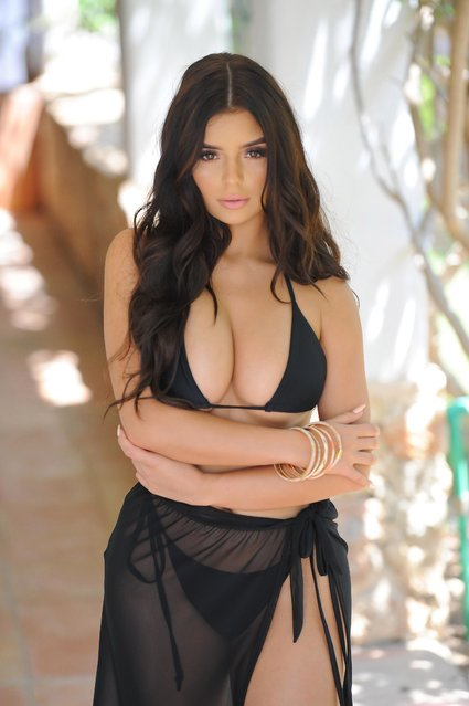"""The social media star Demi Rose, 23, wows her fans and showed off her famous curves as she poses in a thong bikini and high heels for """"I Saw It First"""" in Ibiza, Spain on Monday,  on June 4, 2018. (Photo by KP Pictures)"""