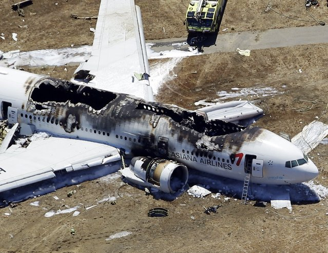 This aerial photo shows the wreckage of the Asiana Flight 214 airplane after it crashed at the San Francisco International Airport in San Francisco, Saturday,  July 6, 2013. (Photo by Marcio Jose Sanchez/AP Photo)
