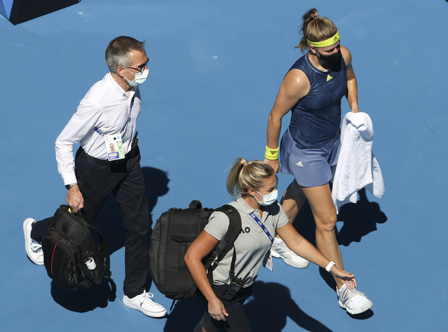 Karolina Muchova, right, of the Czech Republic was from the court for medical treatment during her quarterfinal against Australia's Ash Barty at the Australian Open tennis championship in Melbourne, Australia, Wednesday, February 17, 2021. (Photo by Hamish Blair/AP Photo)
