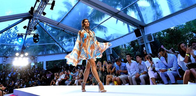 A model walks the runway at the Aqua di Lara show. (Photo by Andrew H. Walker/Getty Images for Mercedes-Benz Fashion Week Swim 2014)