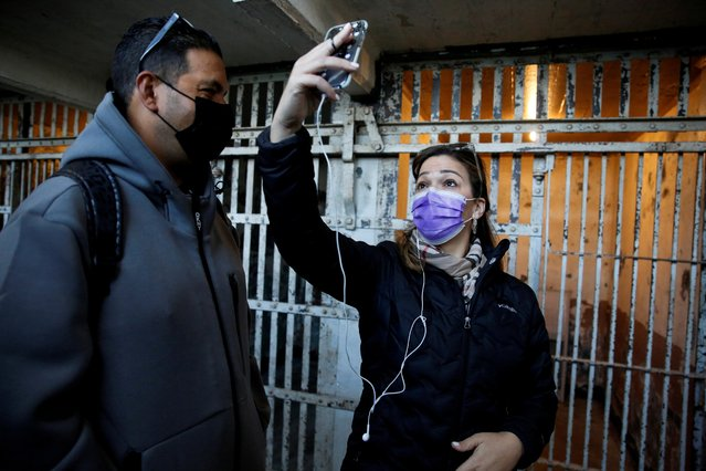 A visitor takes a selfie in front of the jail cells as Alcatraz Island and the famous former prison reopens to the public for indoor tours, after being forced to shut down twice over the past year due to the coronavirus pandemic, in San Francisco Bay, California, March 15, 2021. (Photo by Brittany Hosea-Small/Reuters)