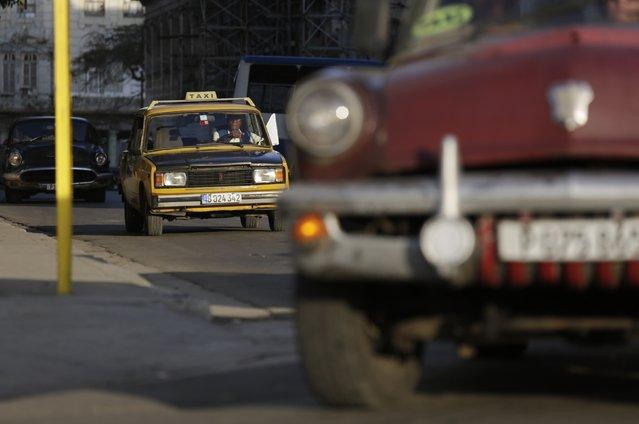A Lada converted into a taxi is seen in Havana February 7, 2015. (Photo by Enrique De La Osa/Reuters)