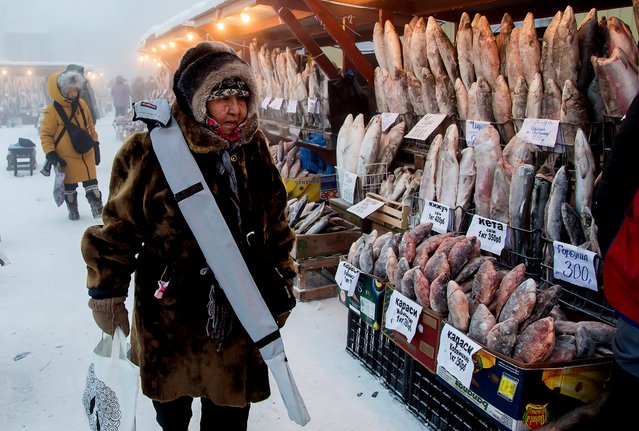 A local woman shops for fish at Central Market in freezing conditions of minus 43 degrees Celsius in the city of Yakutsk, Sakha (Yakutia) on December 13, 2020. Located in Russia's Far East, Yakutia is known for its severe climate. (Photo by Yevgeny Sofroneyev/TASS)
