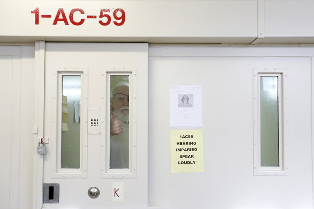 Douglas Clark, 67, who has been on death row for 33 years for murder, gestures from a cell at the Adjustment Center during a media tour of California's Death Row at San Quentin State Prison in San Quentin, California, December 29, 2015. (Photo by Stephen Lam/Reuters)