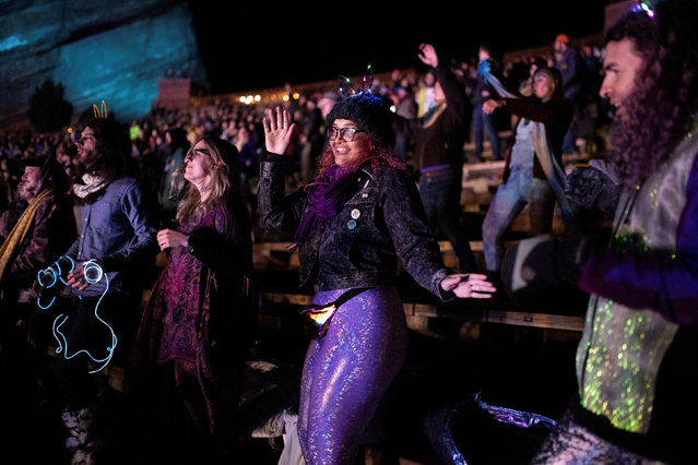 Fans enjoy music as Lotus performs at the opening night of Red Rocks Amphitheatre as coronavirus disease (COVID-19) restrictions are eased with a capacity of 2,500 people in Morrison, Colorado, U.S., April 22, 2021. (Photo by Alyson McClaran/Reuters)