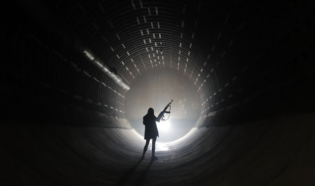 A visitor attends the nuclear defense Bunker 703, at a depth of 43 meters, in Moscow, Russia, 25 April 2021. The recently declassified facility of Cold War period, the bunker was in use by the ministry of Foreign Affairs until 2005. On 2018 was converted into the museum the Bunker 703. (Photo by Maxim Shipenkov/EPA/EFE)