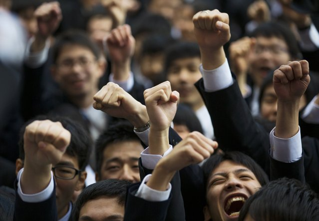 Japanese college graduates shout in a display of self-encouragement during a job-hunting rally at an outdoor theatre in Tokyo February 20, 2015. (Photo by Thomas Peter/Reuters)