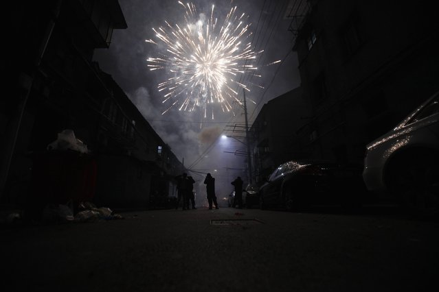 A man sets off fireworks as residents celebrate the start of the Chinese New Year in Shanghai in this February 9, 2013 file photo. (Photo by Carlos Barria/Reuters)