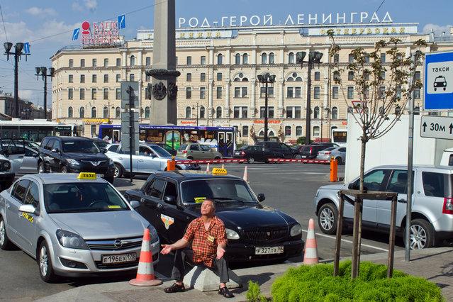 """Meditative taxi driver"". (Ilya Shtutsa)"