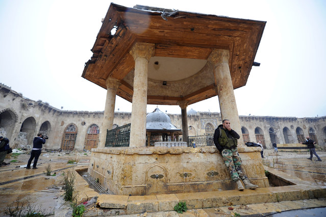 Forces loyal to Syria's President Bashar al-Assad stand inside the Umayyad mosque, in the government-controlled area of Aleppo, during a media tour, Syria December 13, 2016. (Photo by Omar Sanadiki/Reuters)