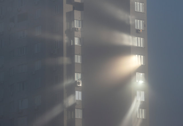 Sunlight reflects from windows of an apartment building on a foggy autumn day in Kiev, Ukraine November 8, 2018. (Photo by Valentyn Ogirenko/Reuters)