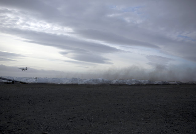 In this January 20, 2015 photo, a plane departs from King George Island, Antarctica. No matter how tourists arrive, weather delays are the norm. During a recent patch of heavy fog, for six days planes were unable to take off or land on King George, leaving guides to deal with frustrated tourists. (Photo by Natacha Pisarenko/AP Photo)