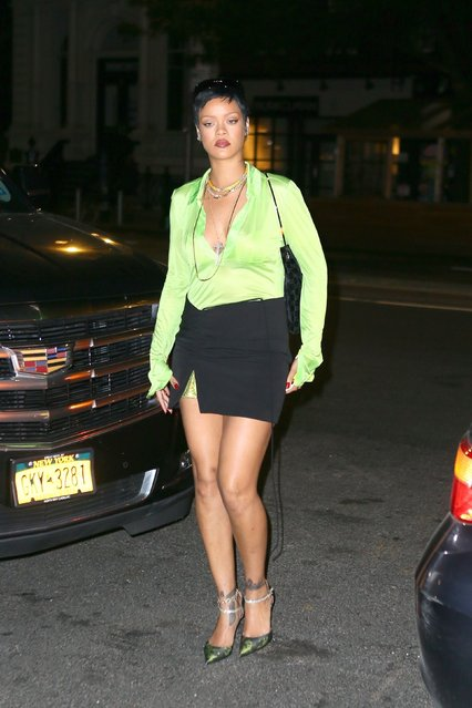 Rihanna stuns outside The Bowery hotel in New York on June 28, 2021 wearing a sheer lime green top with a black skirt displaying her long legs. (Photo by Backgrid USA)
