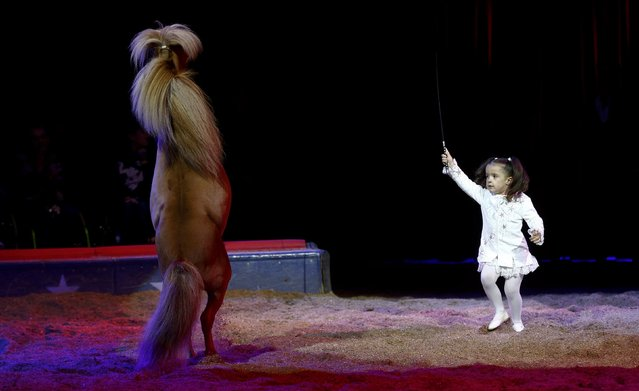 Four year-old Chanel Marie Knie performs with a pony during a rehearsal for the new show of Swiss National-Circus Knie in the town of Rapperswil east of Zurich March 26, 2015. (Photo by Arnd Wiegmann/Reuters)