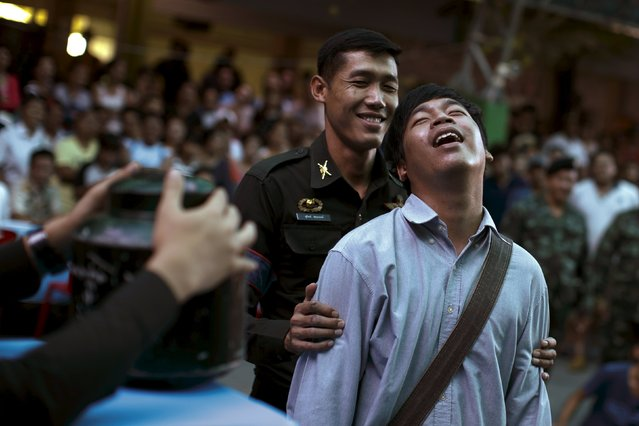 A young man reacts after pulling a ticket out from a plastic bucket during an army draft held at a school in Klong Toey, the dockside slum area in Bangkok April 5, 2015. (Photo by Athit Perawongmetha/Reuters)