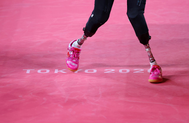 Kubra Korkut of Turkey in action against Viktoriia Safonova of the Russian Paralympic Committee during Class 7 Group B Women's Singles Table Tennis Match on day 2 of the Tokyo 2020 Paralympic Games at Tokyo Metropolitan Gymnasium on August 26, 2021 in Tokyo, Japan. (Photo by Ivan Alvarado/Reuters)