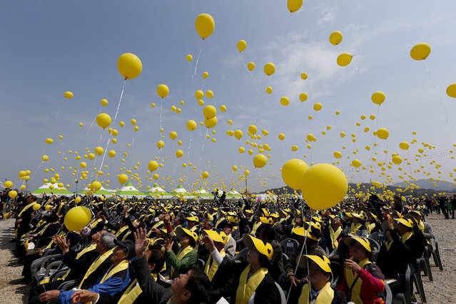 South Korean people fly yellow balloons for Sewol ferry sinking victims to mark the one year anniversary since the disaster, at Jindo-port, on Jindo Island, in the southwestern province of South Jeolla, South Korea, 16 April 2015. The Sewol ferry sank on 16 April 2014 off the coast of South Korea while carrying 476 people on board. Many of the dead were students on an excursion aboard the overloaded vessel. (Photo by Jeon Heon-Kyun/EPA)