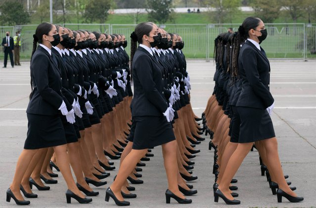 Female members of the PDI (Investigations Police of Chile) march during the traditional military parade as part of the independence day celebrations on September 19, 2021 in Santiago, Chile. This year the militar parade was celebrated with 30% of the staff present in pre-pandemic years. About 6,500 members of the Army, Navy, Air Force, Carabineros and PDI paraded. (Photo by Matias Basualdo/ZUMA Press Wire/Rex Features/Shutterstock)