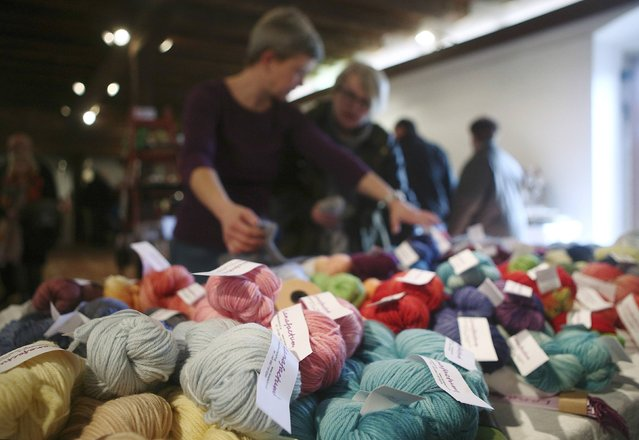 Georgia Spausta (L) displays dyed yarn at a local market in Hollabrunn, Austria March 22, 2015. (Photo by Heinz-Peter Bader/Reuters)