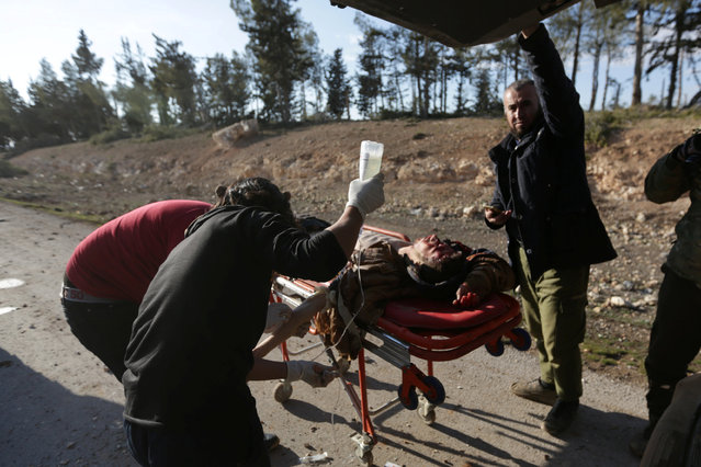 Medics tend to the wounds of a rebel fighter who was injured from a mine on the outskirts of the northern Syrian town of al-Bab, Syria January 28, 2017. (Photo by Khalil Ashawi/Reuters)