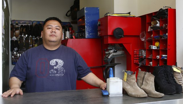 "Quoc Ngui, 37, poses for a photograph at his workplace, Kensal Repairs, in the London constituency of Brent Central, Britain, April 13, 2015. Ngui was born in England and has Vietnamese parents, he said: ""I've met Ed Milliband and Labour will get my vote, he's a charming man"". (Photo by Eddie Keogh/Reuters)"
