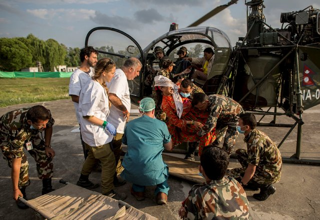 An injured resident is taken off from the helicopter at the Israel Defence Forces (IDF) field hospital following Saturday's earthquake in Kathmandu, Nepal, April 29, 2015. (Photo by Danish Siddiqui/Reuters)