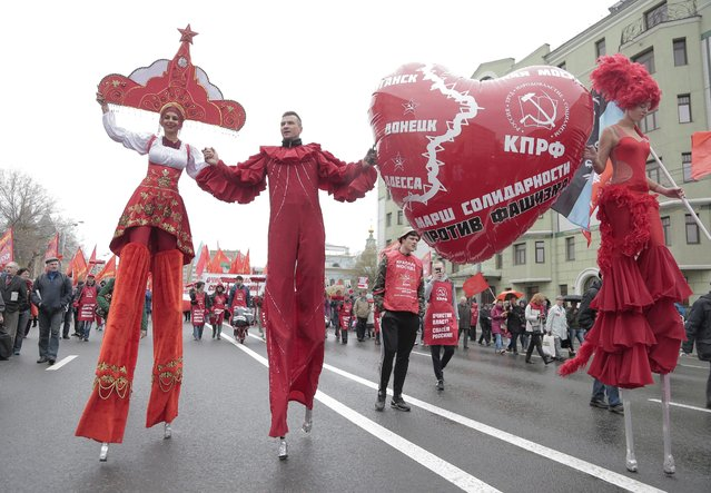 Russian Communist party members and supporters move to the center of Moscow during a traditional May Day demonstration, Russia, 01 May 2015. Some 140,000 workers and students attended the parade on the occasion of Labour Day, also known as International Worker's Day or May Day. (Photo by Maxim Shipenkov/EPA)