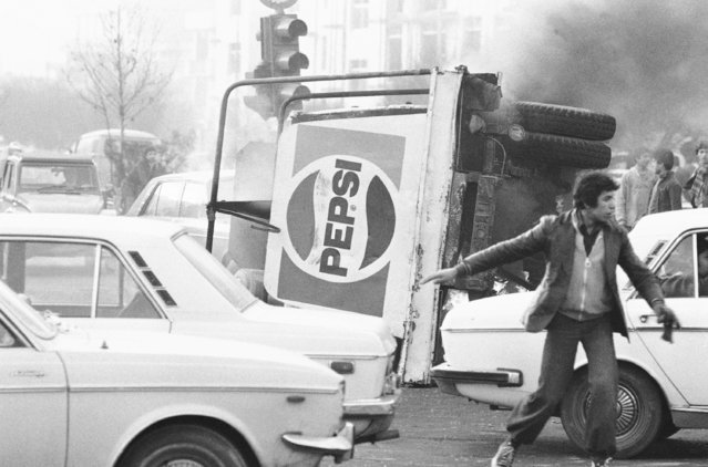 In this December 27, 1978 file photo, an overturned truck with a Pepsi soft drink logo burns during riots in Tehran, Iran. Forty years ago, Iran's ruling shah left his nation for the last time and an Islamic Revolution overthrew the vestiges of his caretaker government. The effects of the 1979 revolution, including the takeover of the U.S. Embassy in Tehran and ensuing hostage crisis, reverberate through decades of tense relations between Iran and America. (Photo by AP Photo/File)