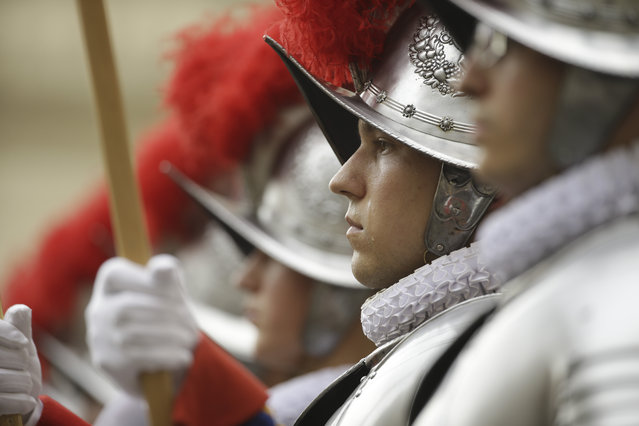 Vatican Swiss guards line up during a swearing-in ceremony, at the Vatican, Wednesday, May 6, 2015. (Photo by Alessandra Tarantino/AP Photo)