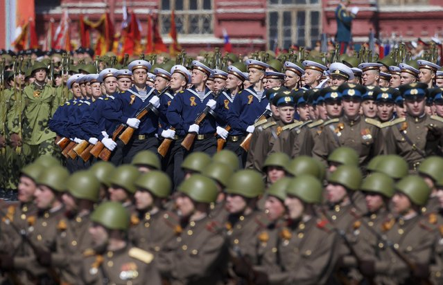 Russian army soldiers, dressed in WWII era uniforms, march along the Red Square during a general rehearsal for the Victory Day military parade which will take place at Moscow's Red Square on May 9 to celebrate 70 years after the victory in WWII, in Moscow, Russia, Thursday, May 7, 2015. (Photo by Ivan Sekretarev/AP Photo)