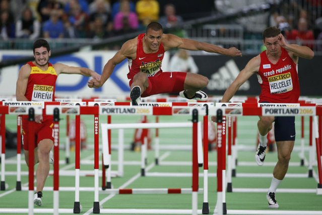 Ashton Eaton of the U.S. (C) clears a hurdle in a heat of the men's 60 meters hurdles portion of the Heptathlon at the IAAF World Indoor Athletics Championships in Portland, Oregon March 19, 2016. (Photo by Lucy Nicholson/Reuters)