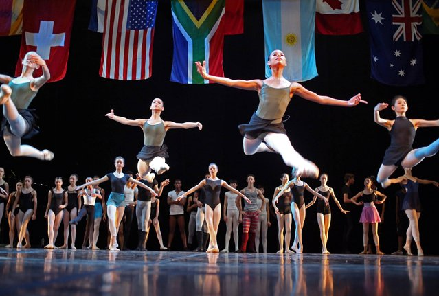 Ballet dancers take part in a practice session before the South African International Ballet Competition to be held in Cape Town, South Africa, Monday, February 17, 2014. The fourth annual ballet competition takes place between Feb. 17-23. It is the only event of its kind on the African continent and attracts top dancers from all over the world. (Photo by Schalk van Zuydam/AP Photo)
