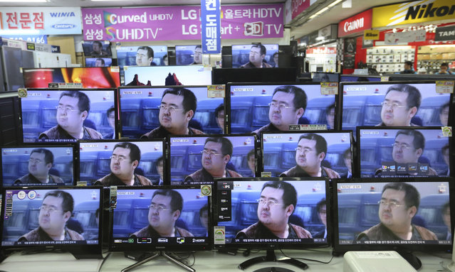 TV screens show pictures of Kim Jong Nam, the half-brother of North Korean leader Kim Jong Un, at an electronic store in Seoul, South Korea, Wednesday, February 15, 2017. Kim was assassinated at an airport in Kuala Lumpur, telling medical workers before he died that he had been attacked with a chemical spray a Malaysian official said Tuesday. (Photo by Ahn Young-joon/AP Photo)
