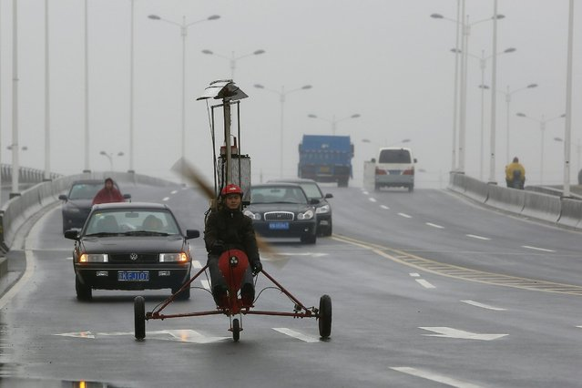 Luo Jinsha drives his self-made aircraft during a test flight on the outskirts of Shanghai, February 26, 2014. Luo, 28, a migrant worker living in Shanghai, spent around eight months and 40,000 yuan ($6,529) to build the plane to fulfil his dream to fly. Despite failing during the first test flight, Luo said he will not give up hope on improving his plane so as to eventually fly it successfully. The aircraft was able to move quickly on the ground but could not take to the air on second attempt. (Photo by Aly Song/Reuters)