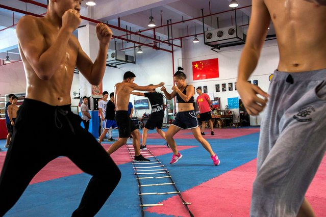 "Huang Wensi in action during her final training session in Ningbo, Zhejiang province, China, before she heads to Taiwan for her Asia Female Continental Super Flyweight Championship match, September 23, 2018. Huang is one of a small but growing number of women in China to embrace professional boxing, relishing its intense nature despite traditional stereotypes that steer women away from such activities. ""A women is not just limited to being a wife or mother in the house"", she said. (Photo by Yue Wu/Reuters)"