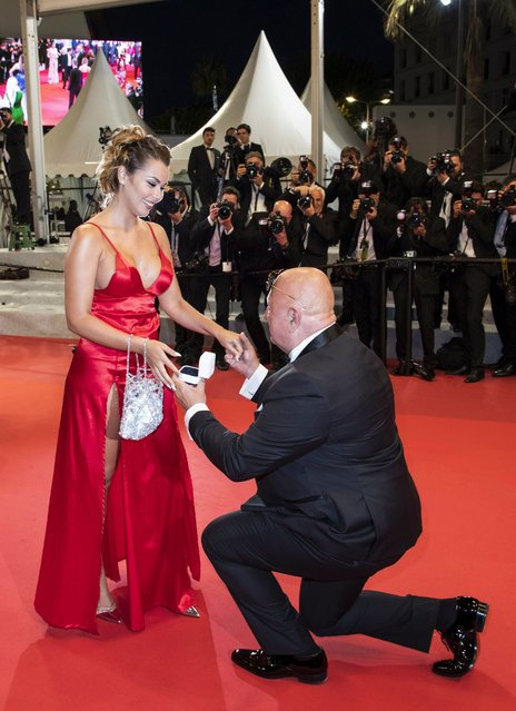 """A guest proposes to his companion on the red carpet as they arrive for the screening of """"Mektoub, My Love: Intermezzo"""" during the 72nd annual Cannes Film Festival, in Cannes, France, 23 May 2019. (Photo by Julien Warnand /EPA/EFE/Rex Features/Shutterstock)"""