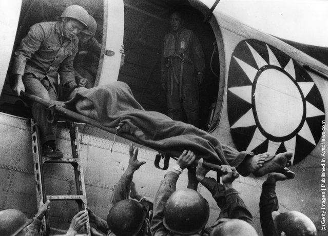 1958: A wounded soldier being flown off the island of Quemoy to Taiwan during a ceasefire between the Nationalist forces and the Chinese Communists