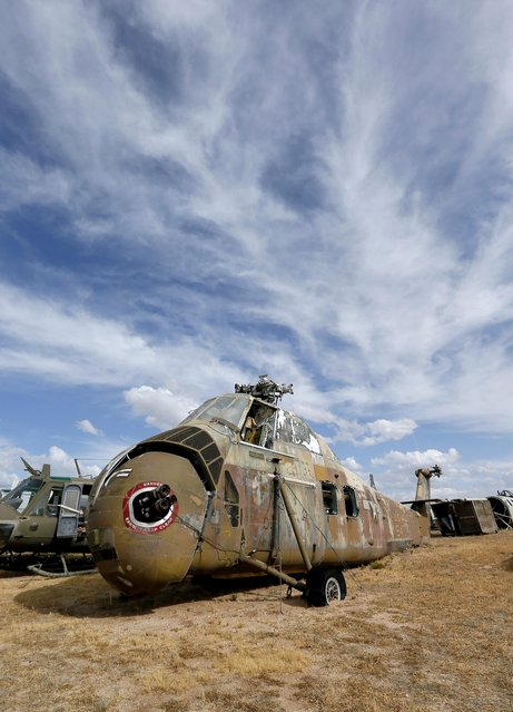 """An Army Sikorsky VH-34s Choctaw helicopter, which was used to transport President Dwight D. Eisenhower, sits in a field at the 309th Aerospace Maintenance and Regeneration Group boneyard at Davis-Monthan Air Force Base in Tucson, Ariz. on Thursday, May 14, 2015. Eisenhower became the first chief executive to be transported by helicopter and the VH-34's served as """"Army One"""" from 1958 through 1963 for Eisenhower and President John F. Kennedy. (Photo by Matt York/AP Photo)"""