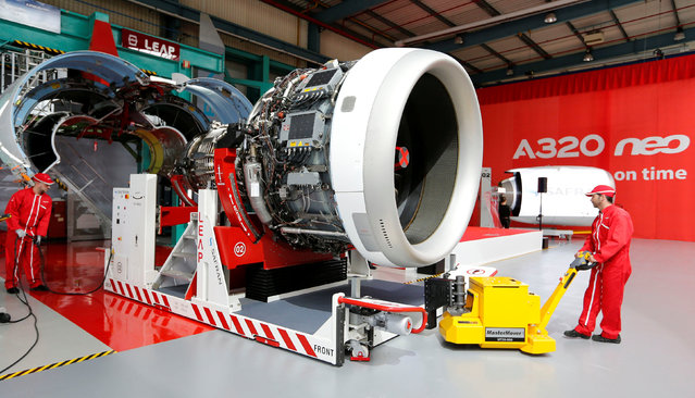 An employee arrives with an engine during the delivery of the first series-production LEAP-1A propulsion systems by Aircelle for the A320neo aircraft Airbus family at the Aircelle plant in Colomiers near Toulouse, Southwestern France, April 15, 2016. (Photo by Regis Duvignau/Reuters)