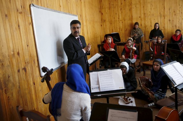 Ahmad Naser Sarmast, head of Afghanistan's National Institute of Music, speaks to members of the Zohra orchestra, an ensemble of 35 women, in Kabul, Afghanistan April 4, 2016. (Photo by Ahmad Masood/Reuters)