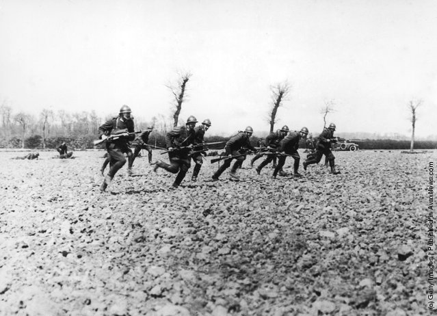 Belgian soldiers make a charge near the River Yser during World War I, circa 1914