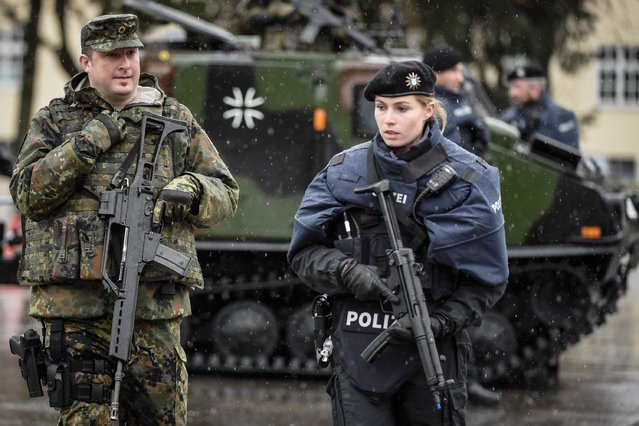 Members of the Bavarian police and the Bundeswehr, the German armed forces, guard a vehicle checkpoint as they demonstrate a dynamic operation as part of the GETEX anti-terror exercises during a media event on March 9, 2017 in Murnau, Germany. (Photo by Philipp Guelland/Getty Images)