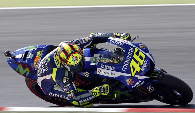 Yamaha's Moto GP rider Valentino Rossi, from Italy, steers his bike during the third free practice for the motorcycle GP in Montmelo, Spain, Saturday, June 13, 2015. The Catalunya Grand Prix will take place on Sunday in Montmelo. (AP Photo/Manu Fernandez)
