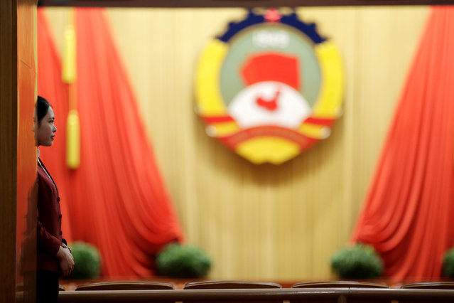 An attendant stands ahead of the closing session of the Chinese People's Political Consultative Conference (CPPCC) at the Great Hall of the People in Beijing, China, March 13, 2017. (Photo by Jason Lee/Reuters)