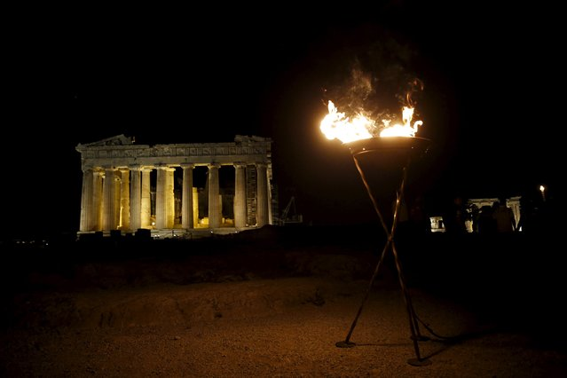 A cauldron set alight with the Olympic Flame is pictured atop the Acropolis hill as the Parthenon temple is seen in the background in Athens, Greece, April 26, 2016. (Photo by Alkis Konstantinidis/Reuters)
