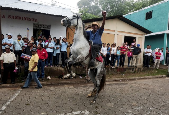A man rides a horse as he takes part in celebrations in honour of San Juan Bautista in the town of San Juan de Oriente, Nicaragua June 26, 2015. (Photo by Oswaldo Rivas/Reuters)