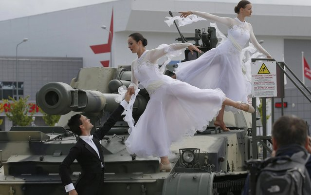 Dancers on a 2S3M Akatsiya 152mm self-propelled howitzer at the opening of the 2019 International Army Games at the Patriot Congress and Exhibition Centre in Kubinka outside Moscow, Russia on August 3, 2019. (Photo by Sergei Karpukhin/TASS)