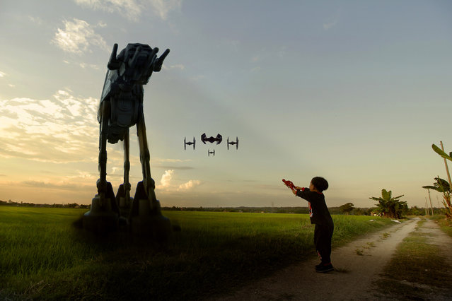"""A """"Star Wars"""" superfan has brought the universe to his backyard. Amateur photographer Zahir Batin, from Selangor in Malaysia, added stormtroopers, X-wings and other famous sights to his native Tanjong Karang rice fields. (Photo by Zahir Batin/Mercury Press)"""