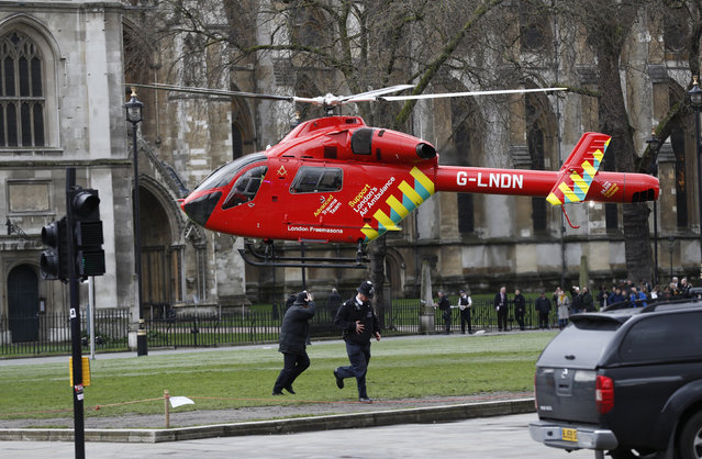 An air ambulance lands in Parliament Square during an incident on Westminster Bridge in London, Britain on Wednesday, March 22, 2017. (Photo by Stefan Wermuth/Reuters)
